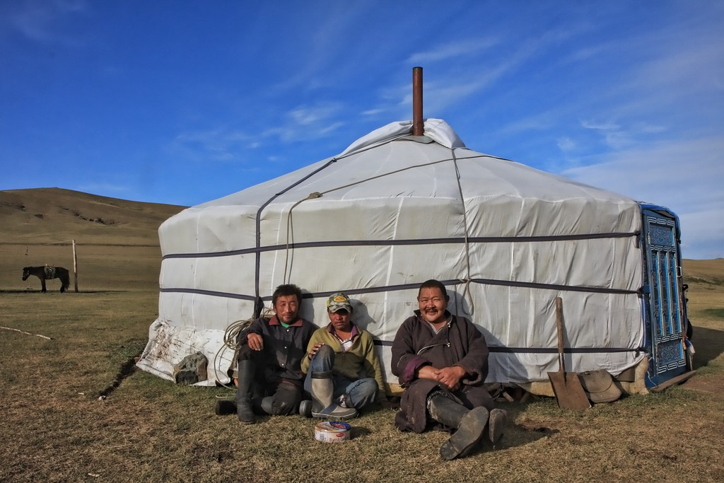 Neighbors sit outside their ger in Terelj National Park